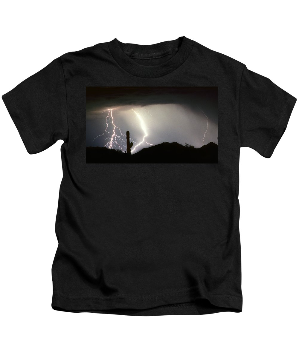 Lightning Kids T-Shirt featuring the photograph Ridin The Southwest Desert Storm Out by James BO Insogna