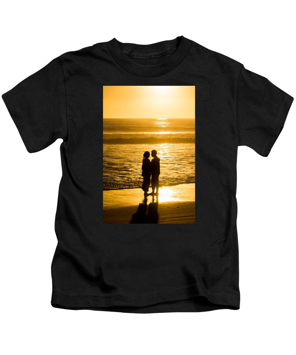 Romantic Beach Silhouette Kids T-Shirt featuring the photograph Romantic Beach Silhouette by Robert VanDerWal