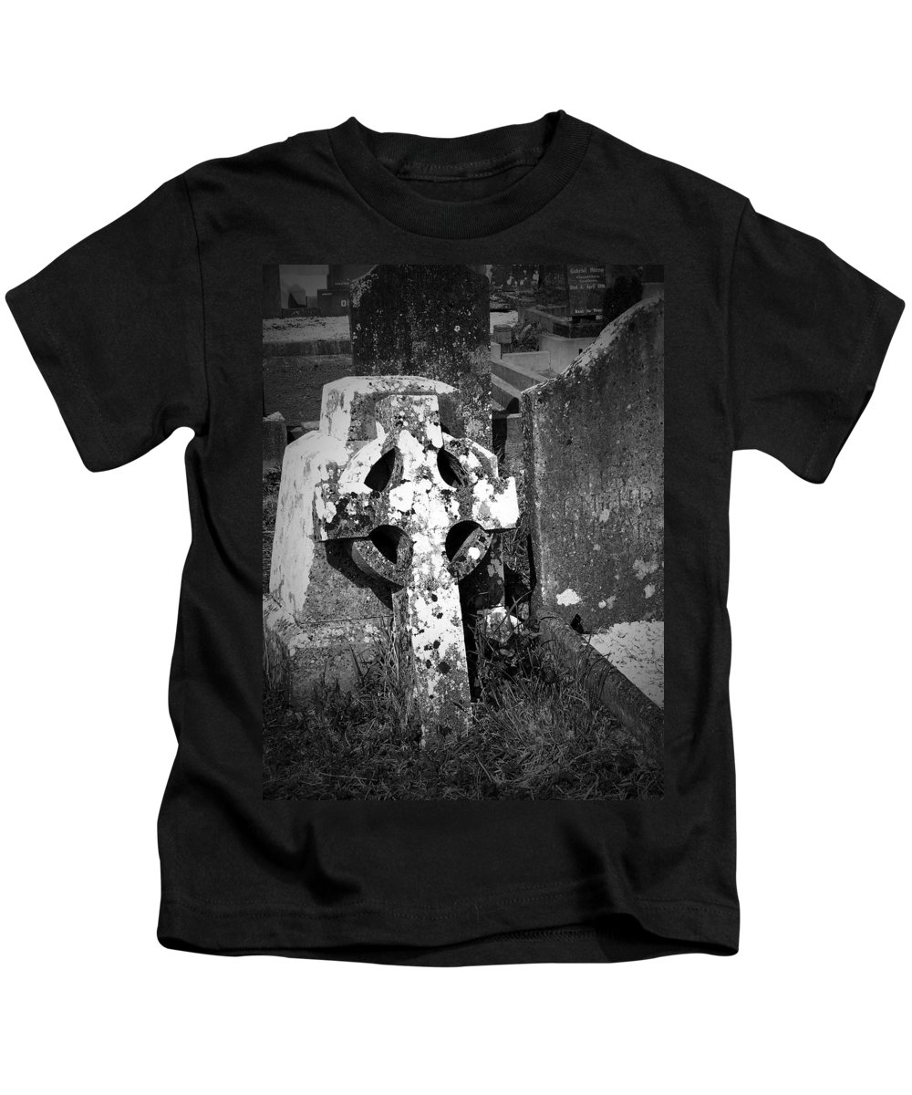 Celtic Kids T-Shirt featuring the photograph Rugged Cross At Fuerty Cemetery Roscommon Ireland by Teresa Mucha