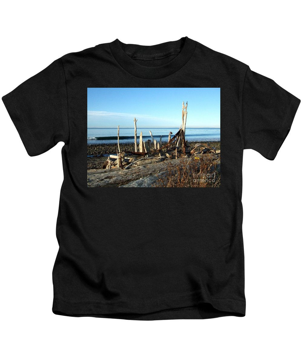 Still Life Kids T-Shirt featuring the photograph Seth's Seaside Driftwood Sculpture by Delores Malcomson