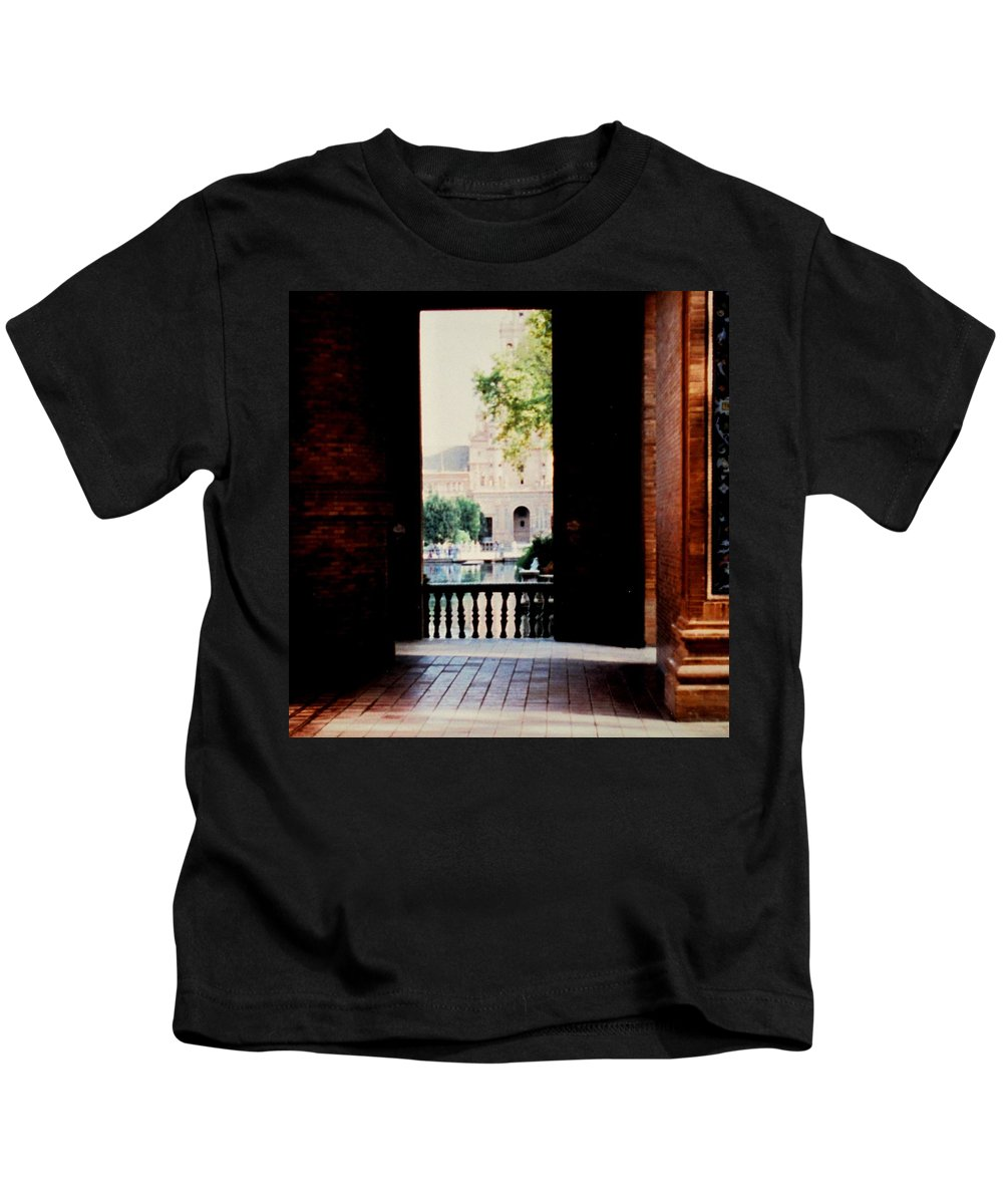 Seville Kids T-Shirt featuring the photograph Seville by Ian MacDonald