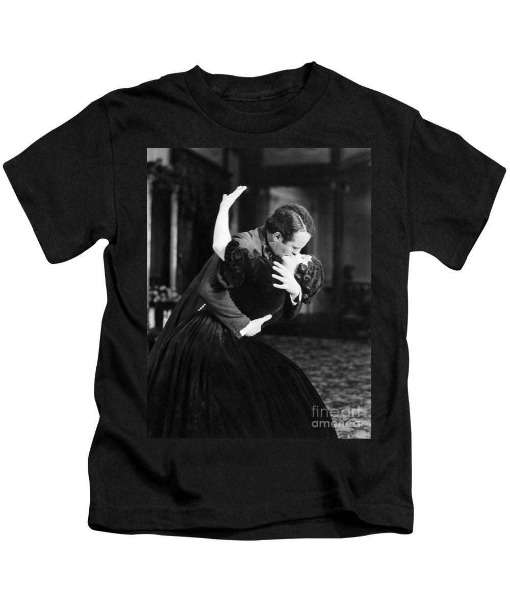 -kissing- Kids T-Shirt featuring the photograph Silent Film Still by Granger