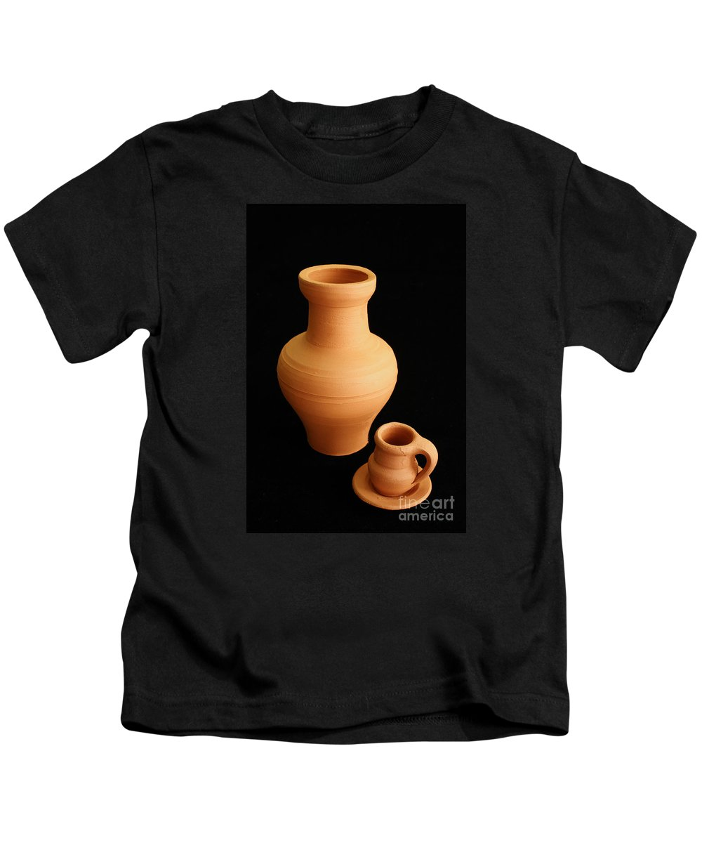 Ceramics Kids T-Shirt featuring the photograph Small Pottery Items by Gaspar Avila