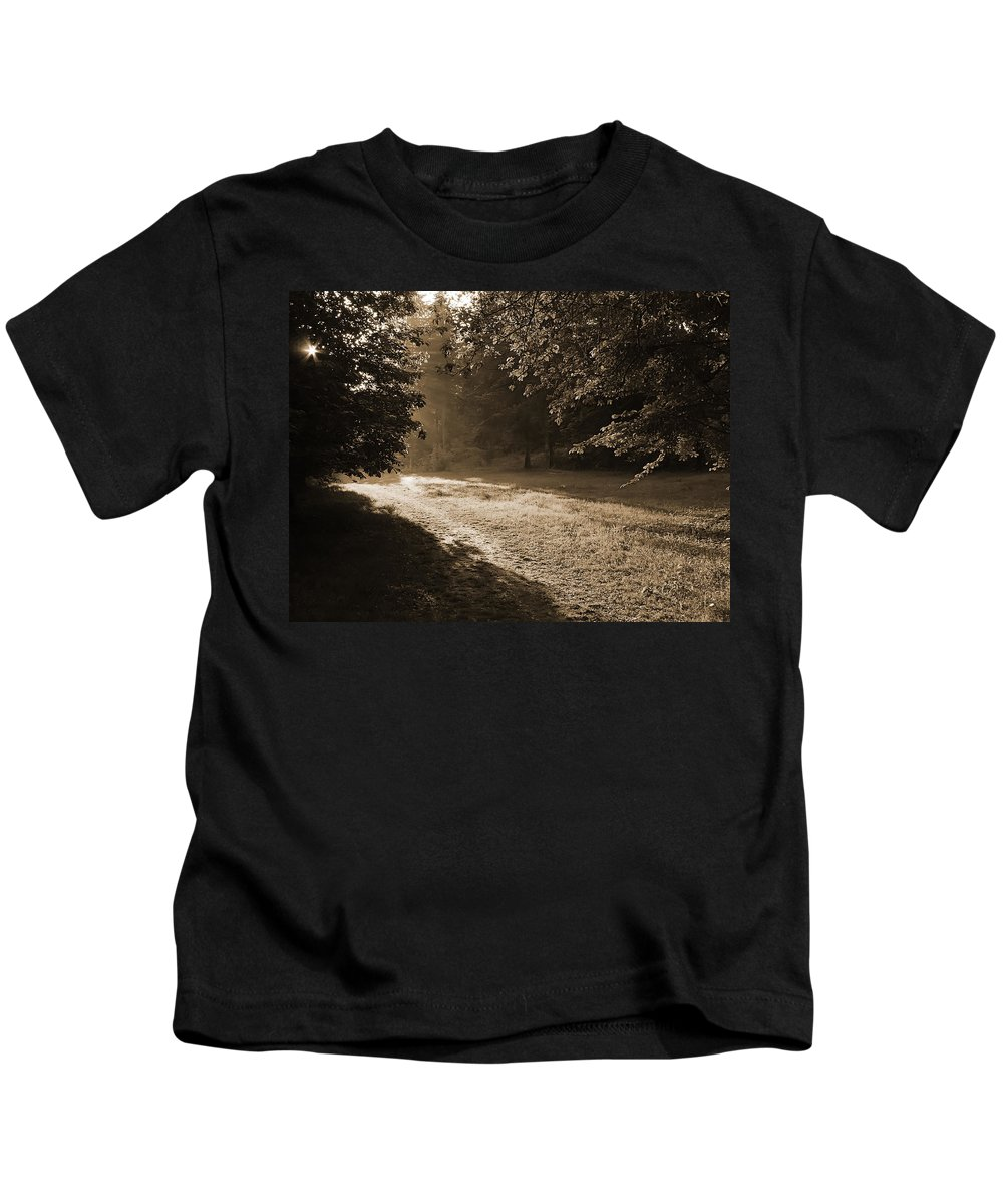 Light Kids T-Shirt featuring the photograph Step Out Of The Shadow by Daniel Csoka