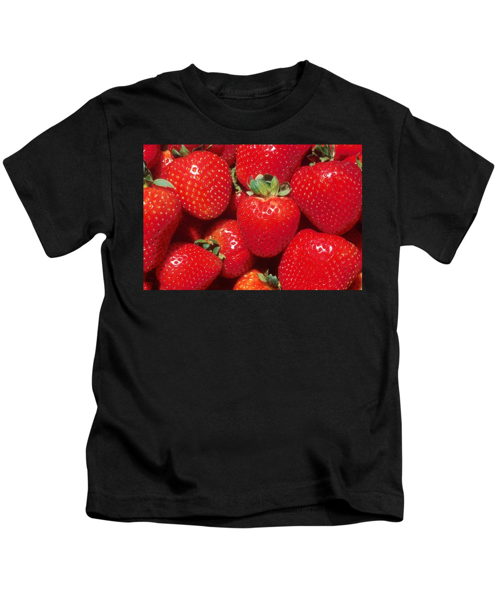 Strawberry Kids T-Shirt featuring the photograph Strawberries by PhotographyAssociates