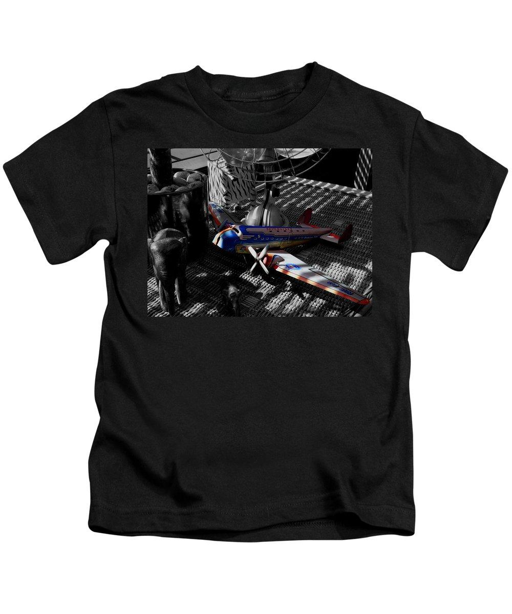 Still Life Kids T-Shirt featuring the photograph Suburban Safari The Zebra Strikes Back by Charles Stuart