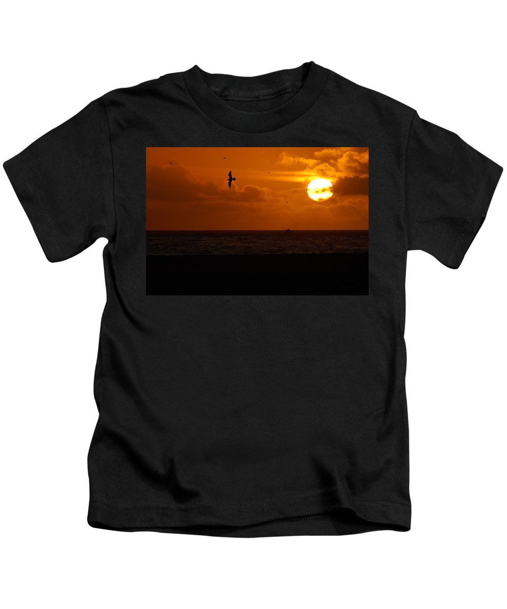 Clay Kids T-Shirt featuring the photograph Sundown Flight by Clayton Bruster