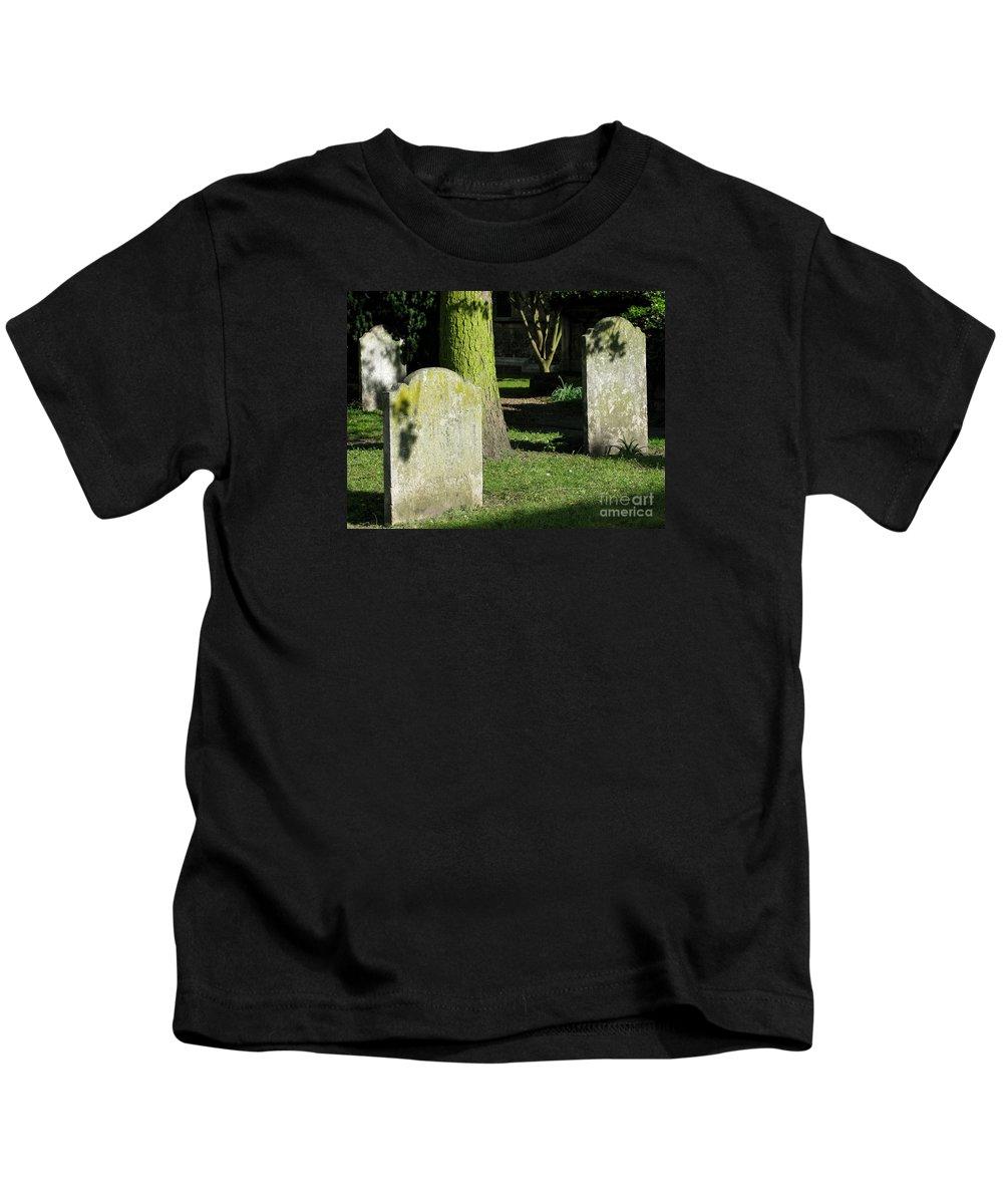 Churchyard Kids T-Shirt featuring the photograph Sunlit Churchyard by Ann Horn