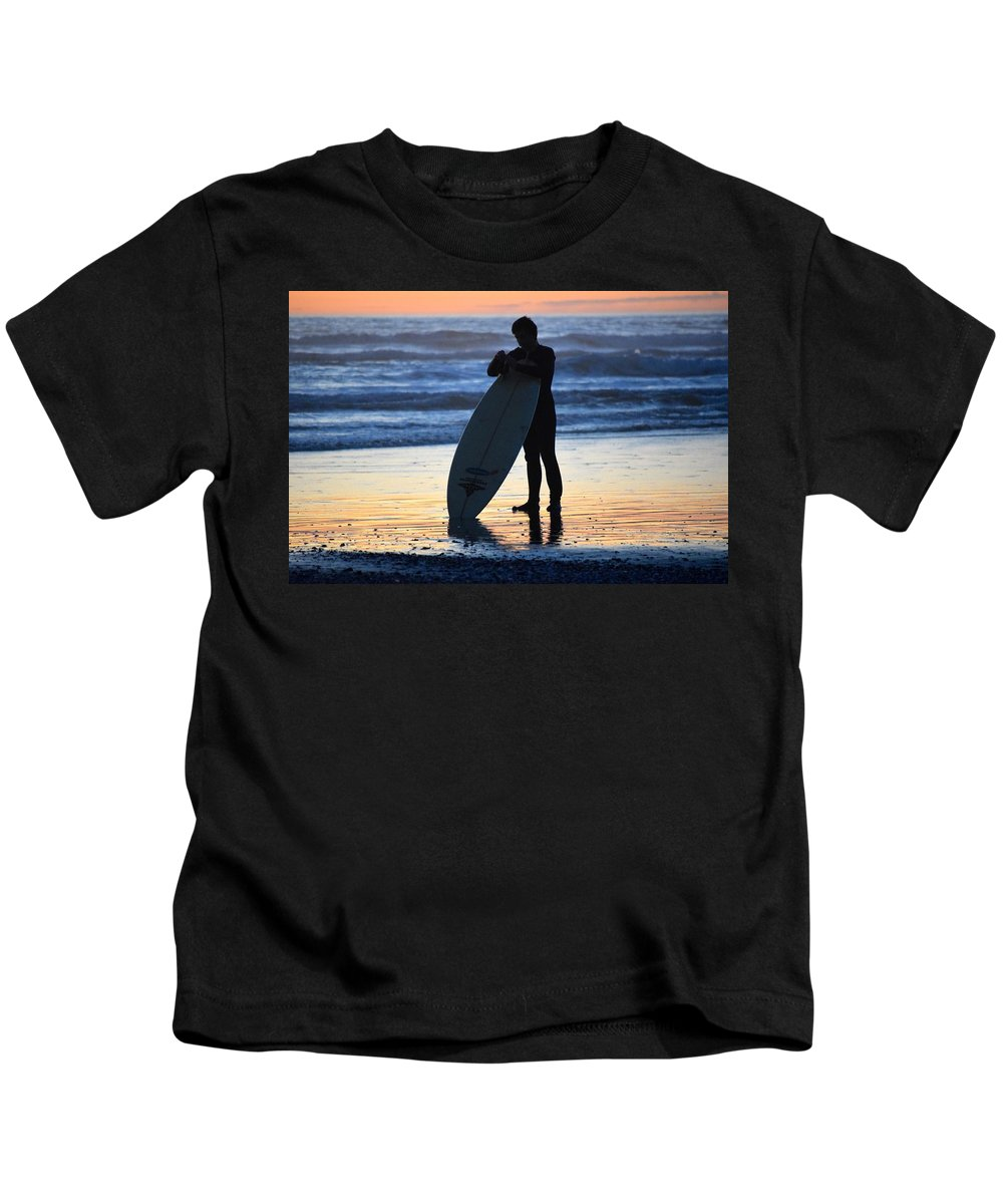 Photo Of A Surfer Kids T-Shirt featuring the photograph Surfer by Janet Darling