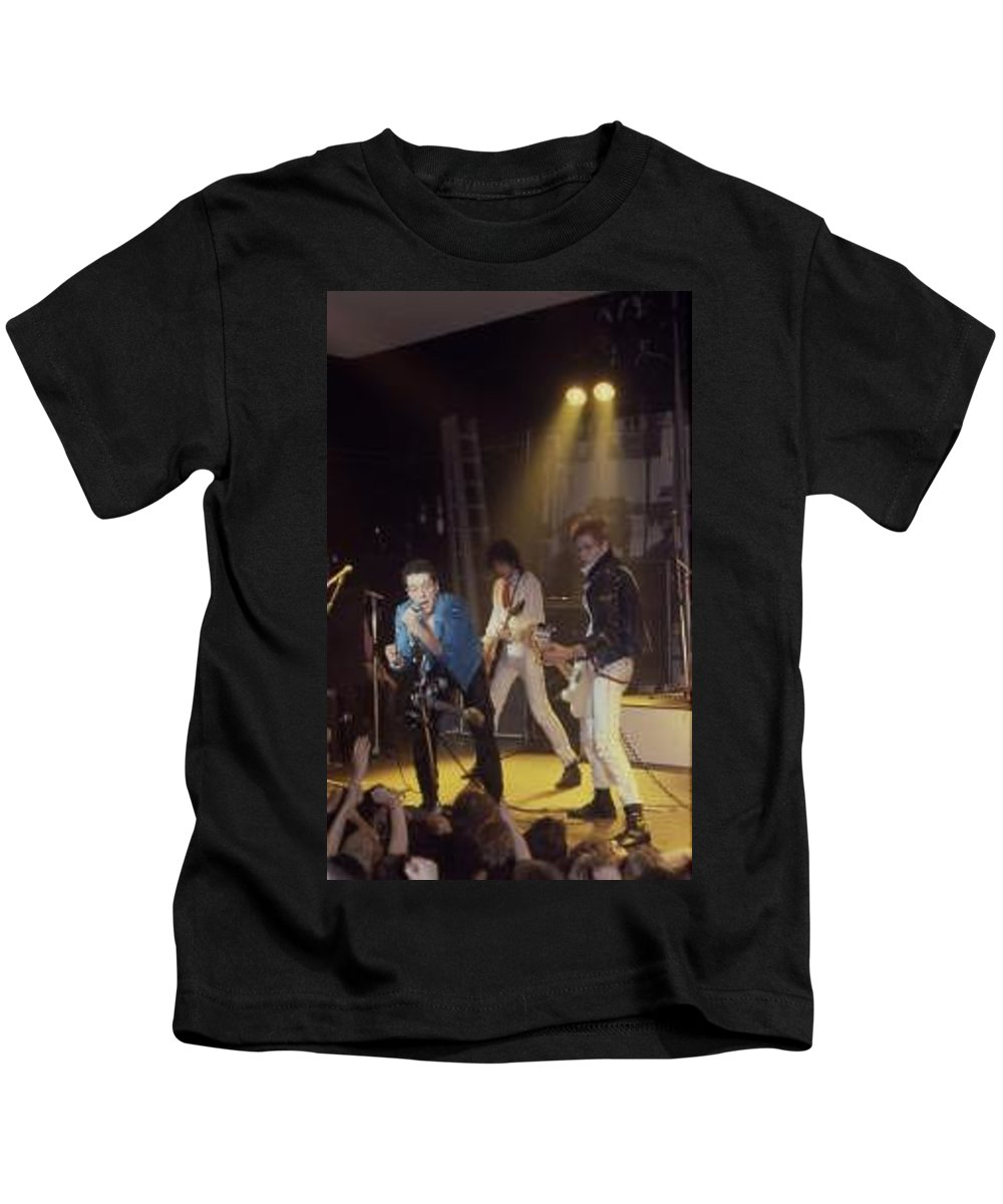 The Clash-london 1978 Photo By Dawn Wirth-copyrighted Kids T-Shirt featuring the photograph The Clash-london - July 1978 by Dawn Wirth