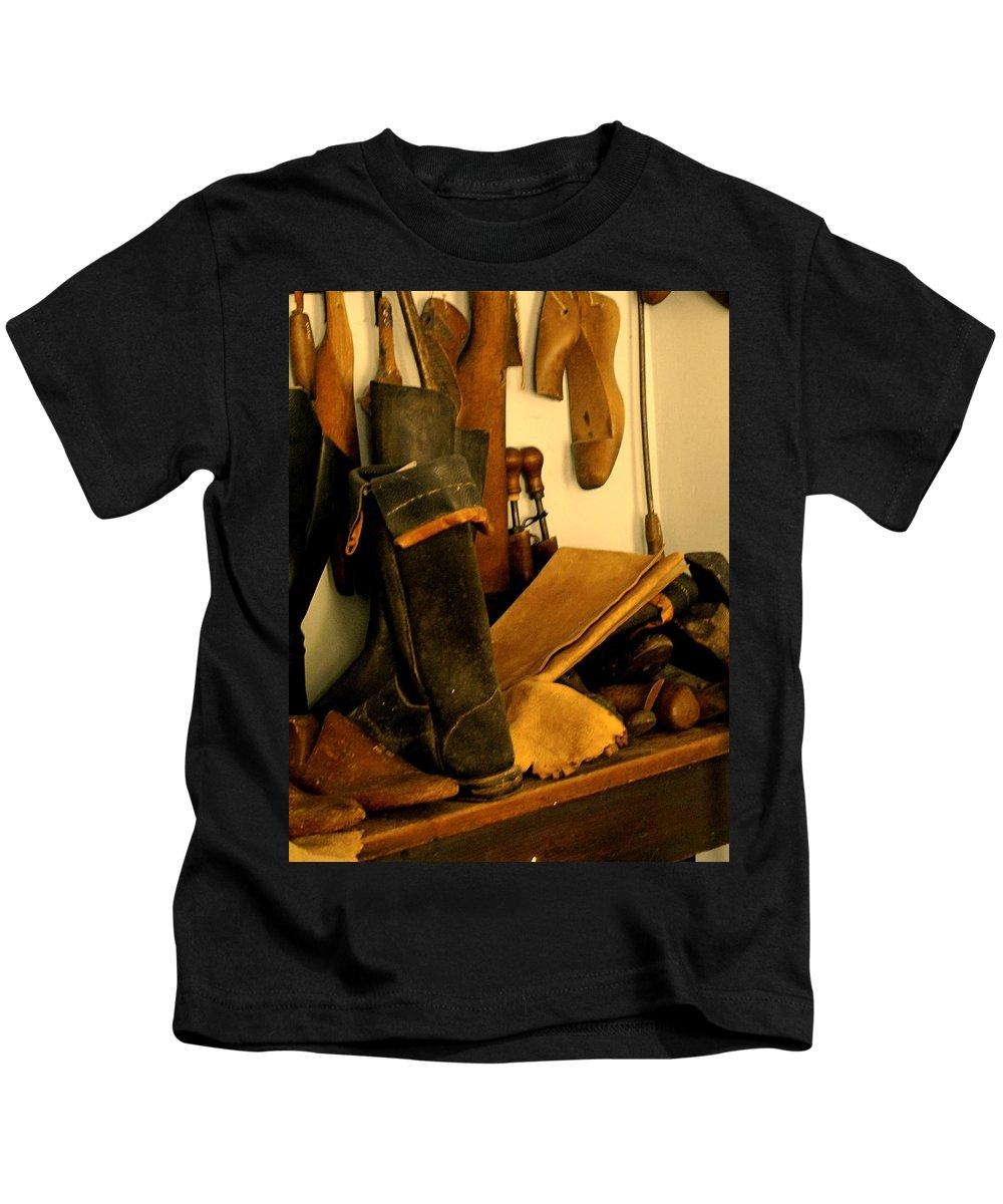 Shoess Kids T-Shirt featuring the photograph The Cobbler by Ian MacDonald