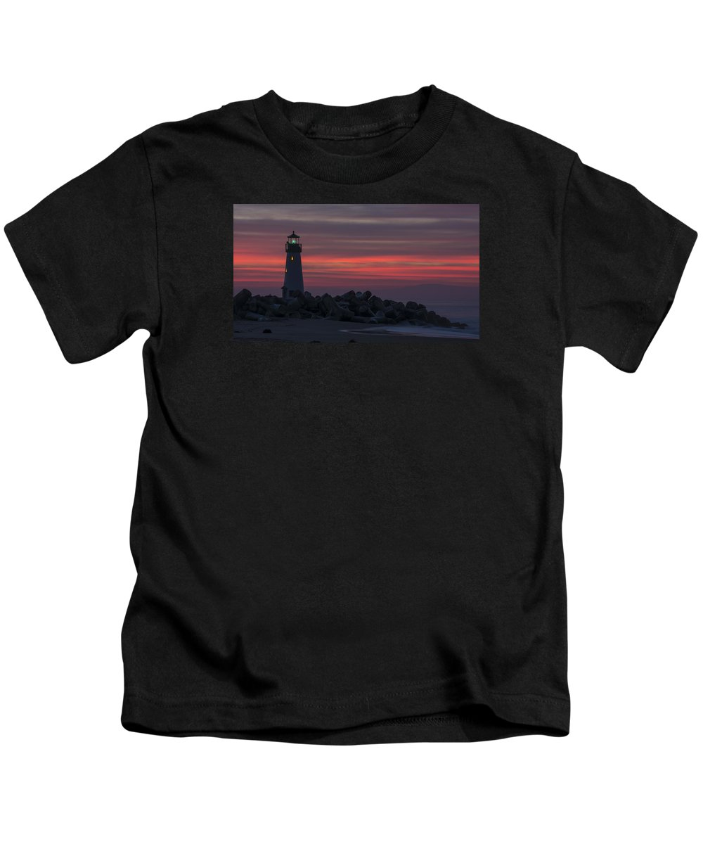 Sunrise Kids T-Shirt featuring the photograph The Harbor Light At Dawn by Bruce Frye