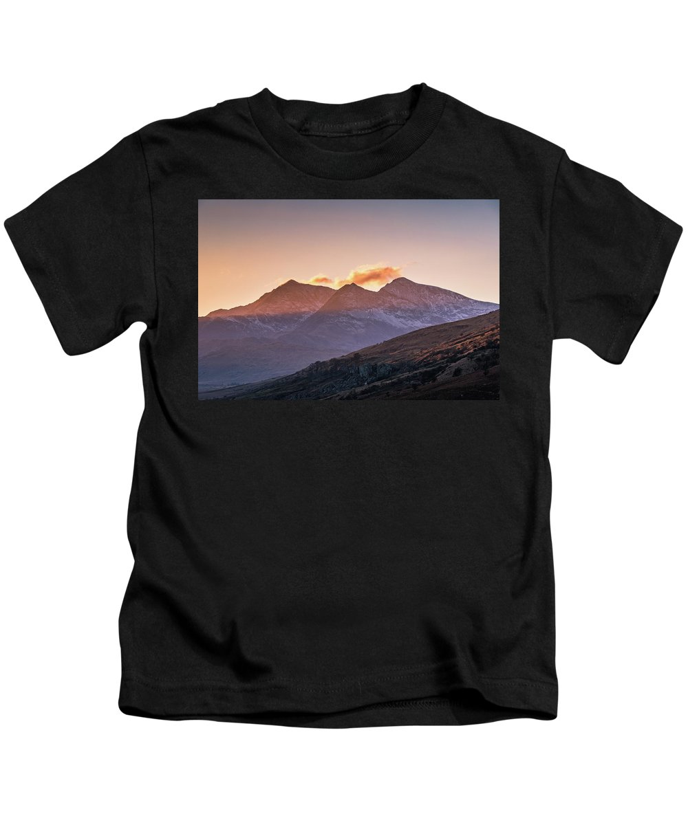 Snowdon Kids T-Shirt featuring the photograph The Last Light Of The Day Over Snowdon. by Paul Downey
