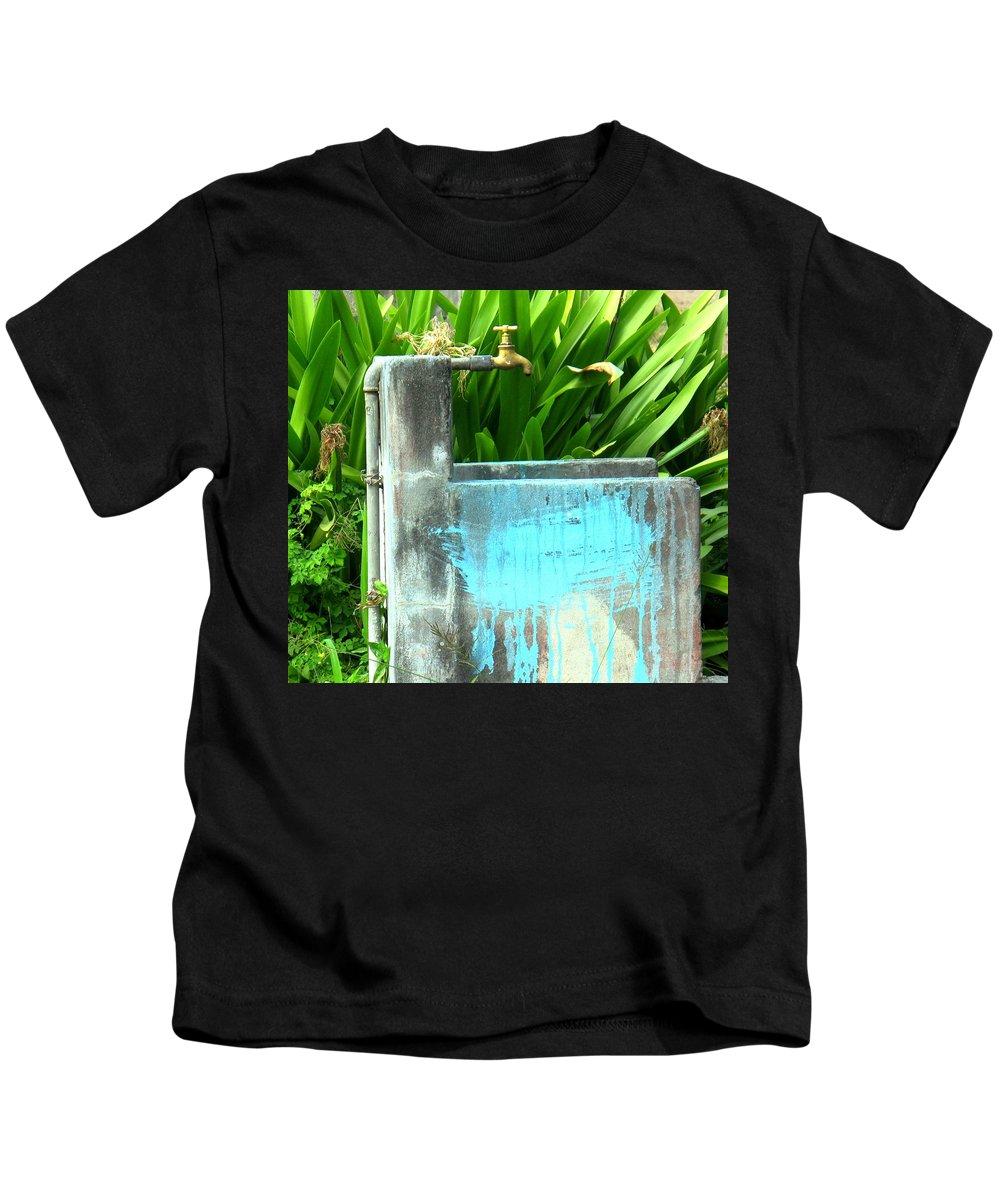 Water Kids T-Shirt featuring the photograph The Neighborhood Water Pipe by Ian MacDonald