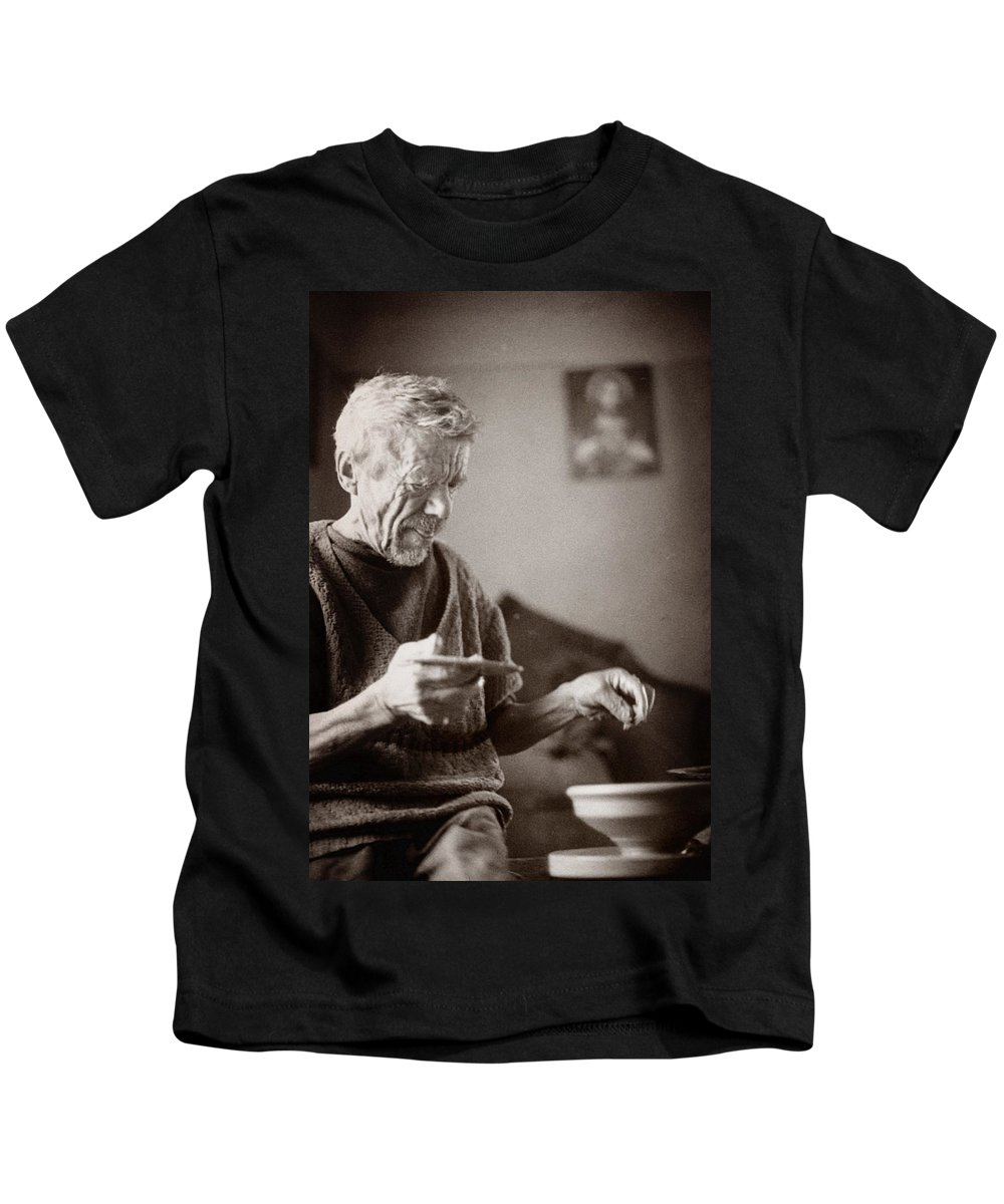 Ukraine Kids T-Shirt featuring the photograph The Potter Of Haweryvschyna by Yuri Lev