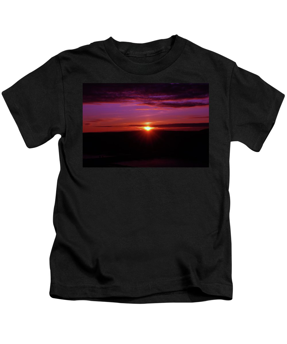 Sunsets Kids T-Shirt featuring the photograph The Settling Time by Jeff Swan