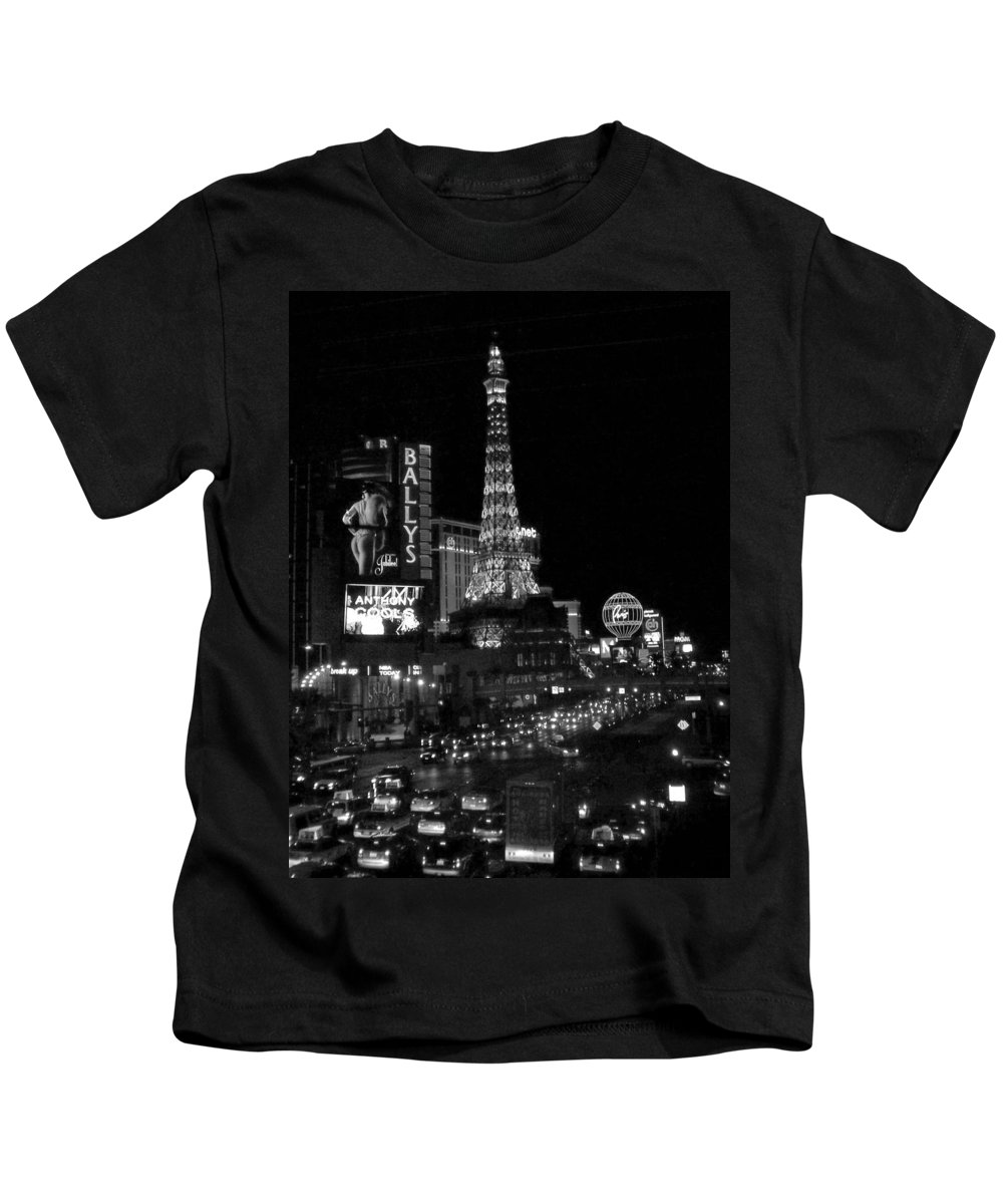 Las Vegas Strip Kids T-Shirt featuring the photograph The Strip By Night B-w by Anita Burgermeister
