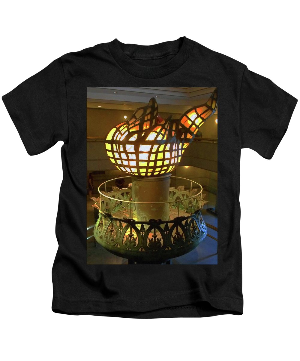 New York City Kids T-Shirt featuring the photograph The Torch 3 by Ron Kandt