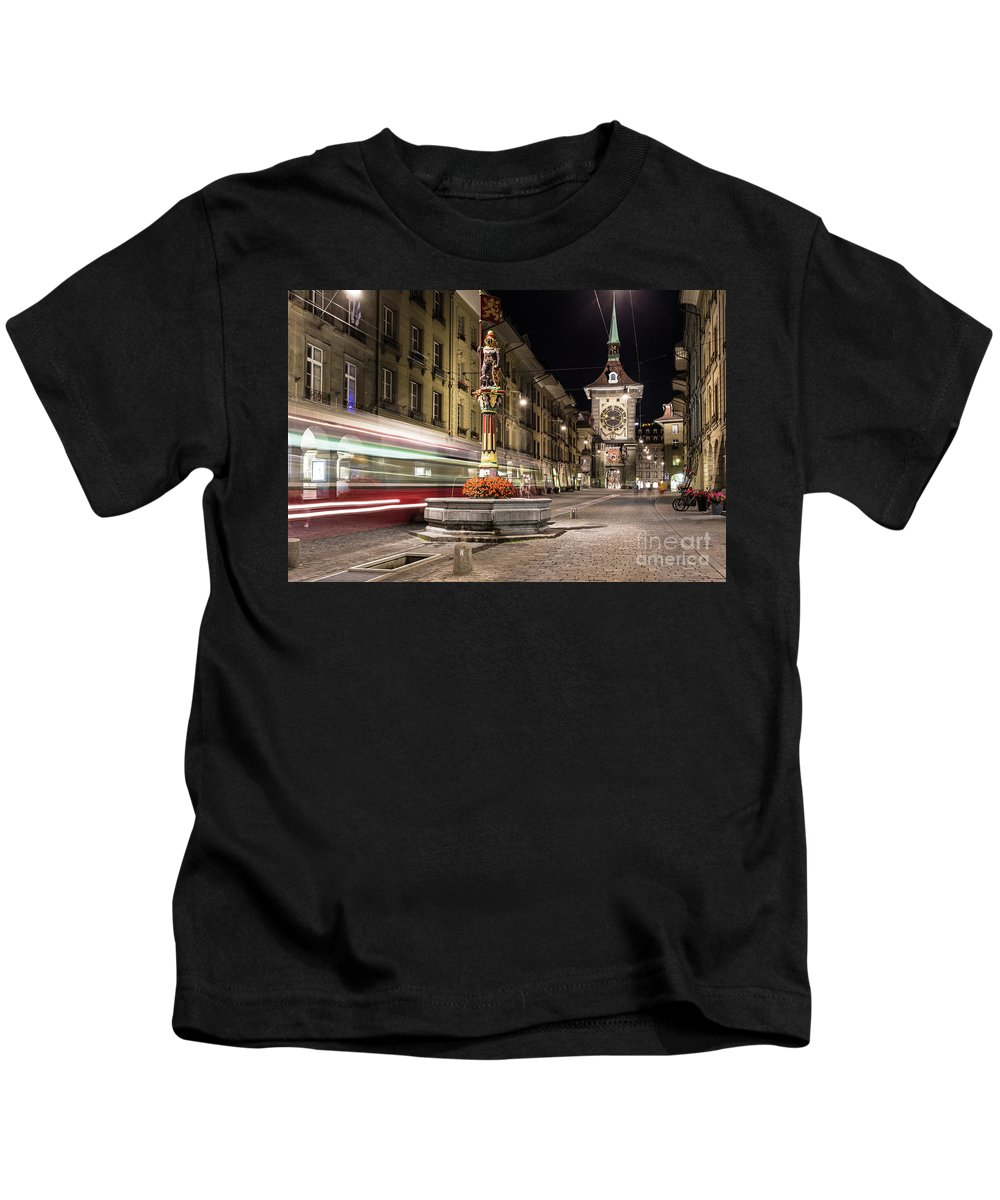 Bern Kids T-Shirt featuring the photograph Tram Rushes In The Street Of Bern by Didier Marti