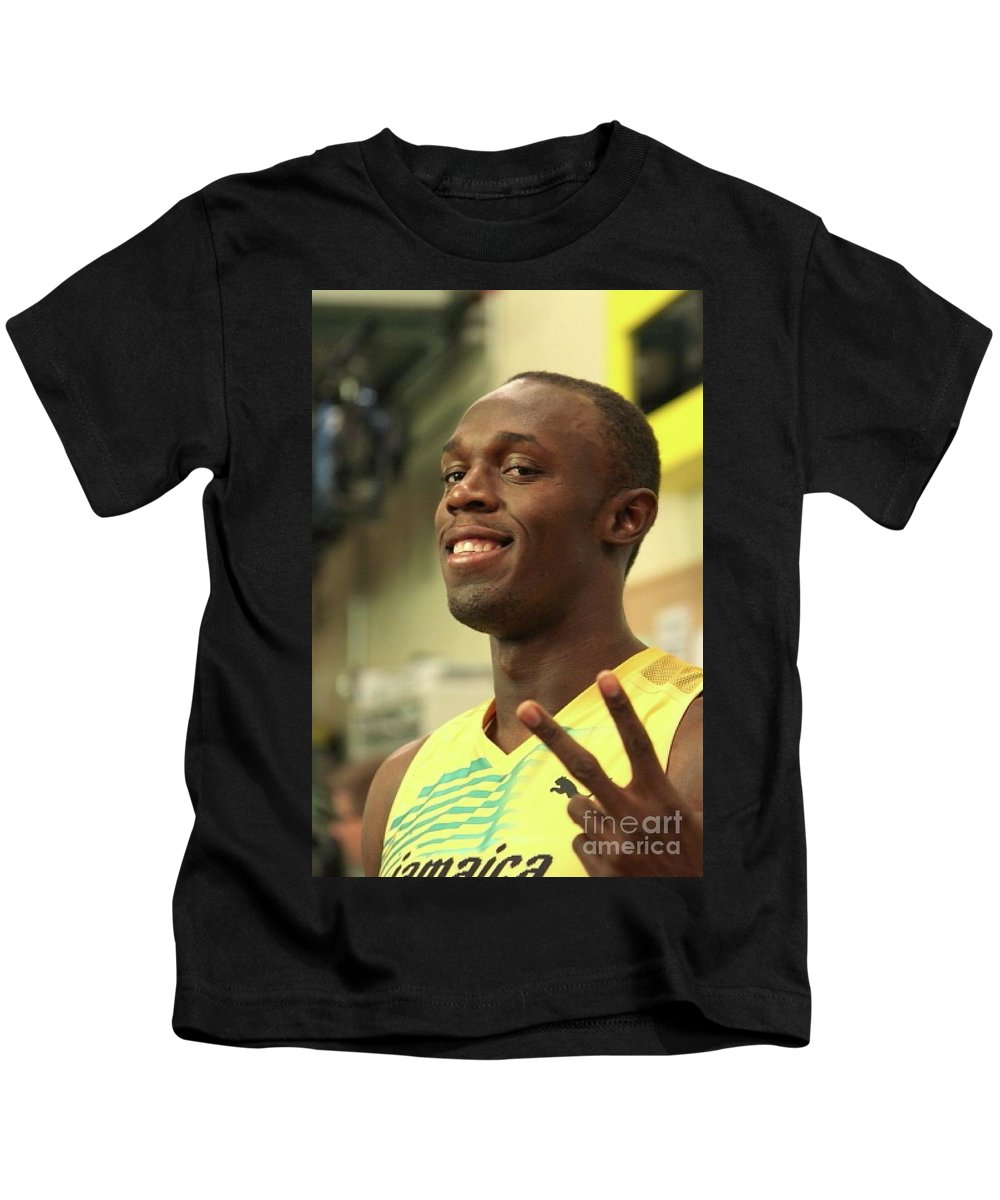 Running Champion Usain Bolt Is Shown Posing For The Camera In This Close Up Photo. Kids T-Shirt featuring the photograph Usain Bolt by Concert Photos