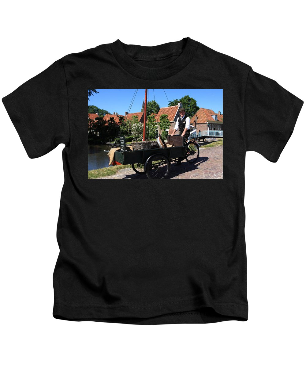 Bicycle Kids T-Shirt featuring the photograph Village Peddler by Aidan Moran