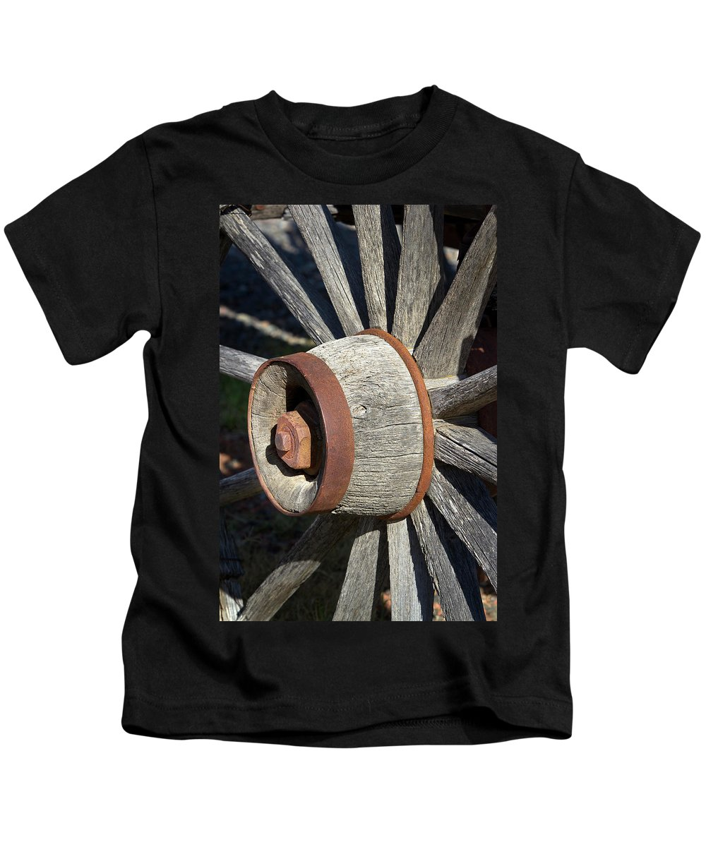 Wheel Kids T-Shirt featuring the photograph Wagon Wheel Hub by Phyllis Denton