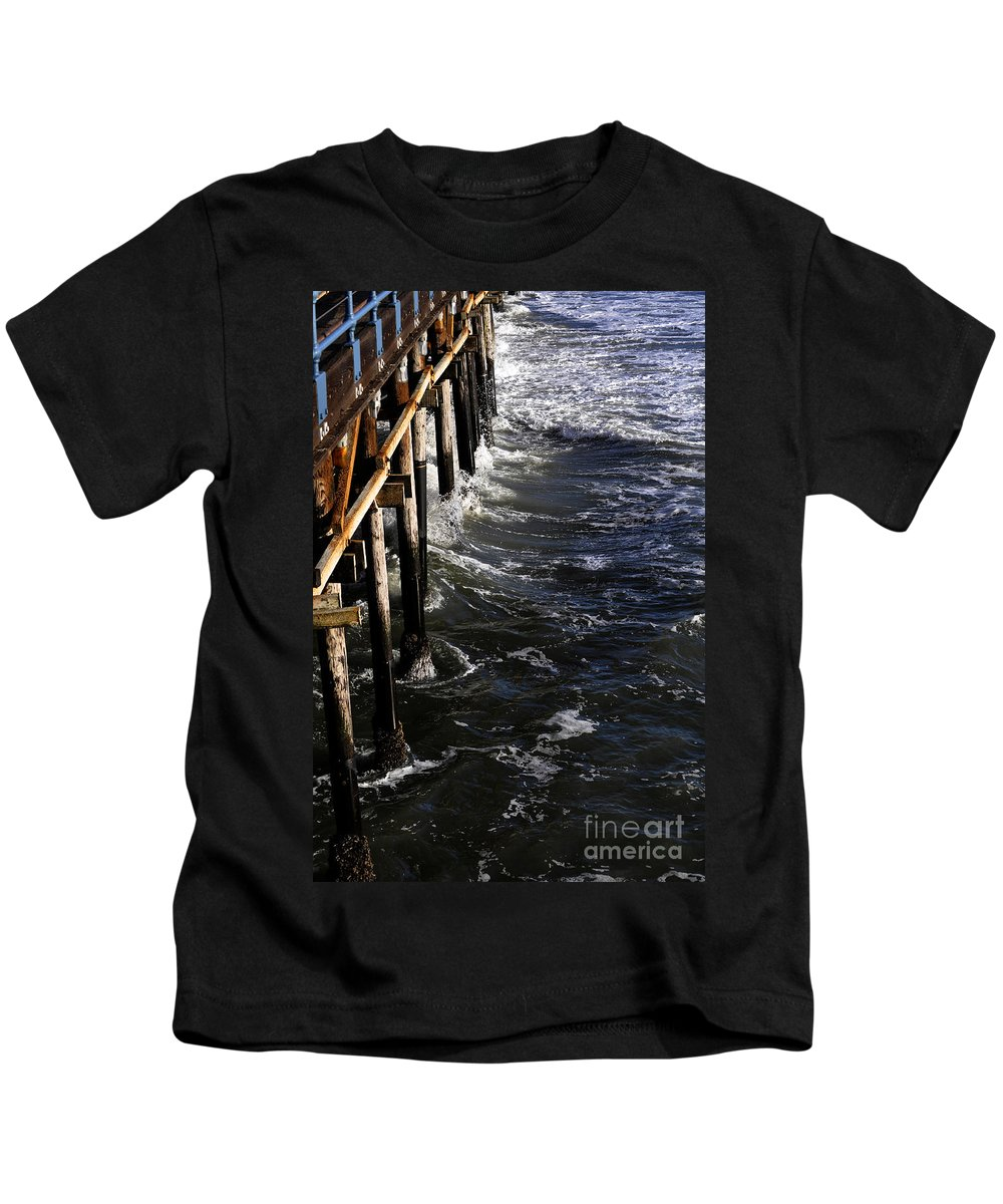 Clay Kids T-Shirt featuring the photograph Waves Hitting Santa Monica Pier by Clayton Bruster