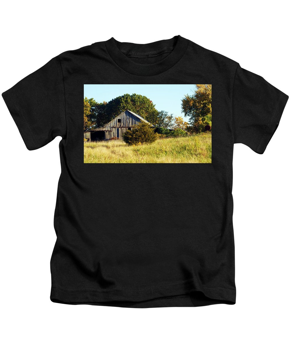 Barn Kids T-Shirt featuring the photograph Weathered Barn In Fall by Cricket Hackmann