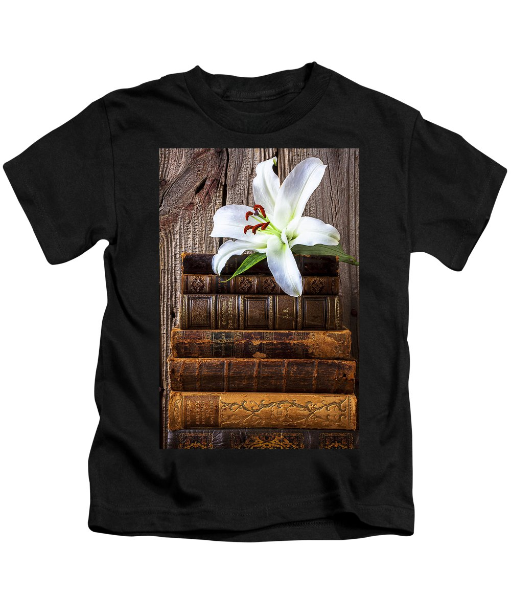 White Lily Kids T-Shirt featuring the photograph White Lily On Antique Books by Garry Gay