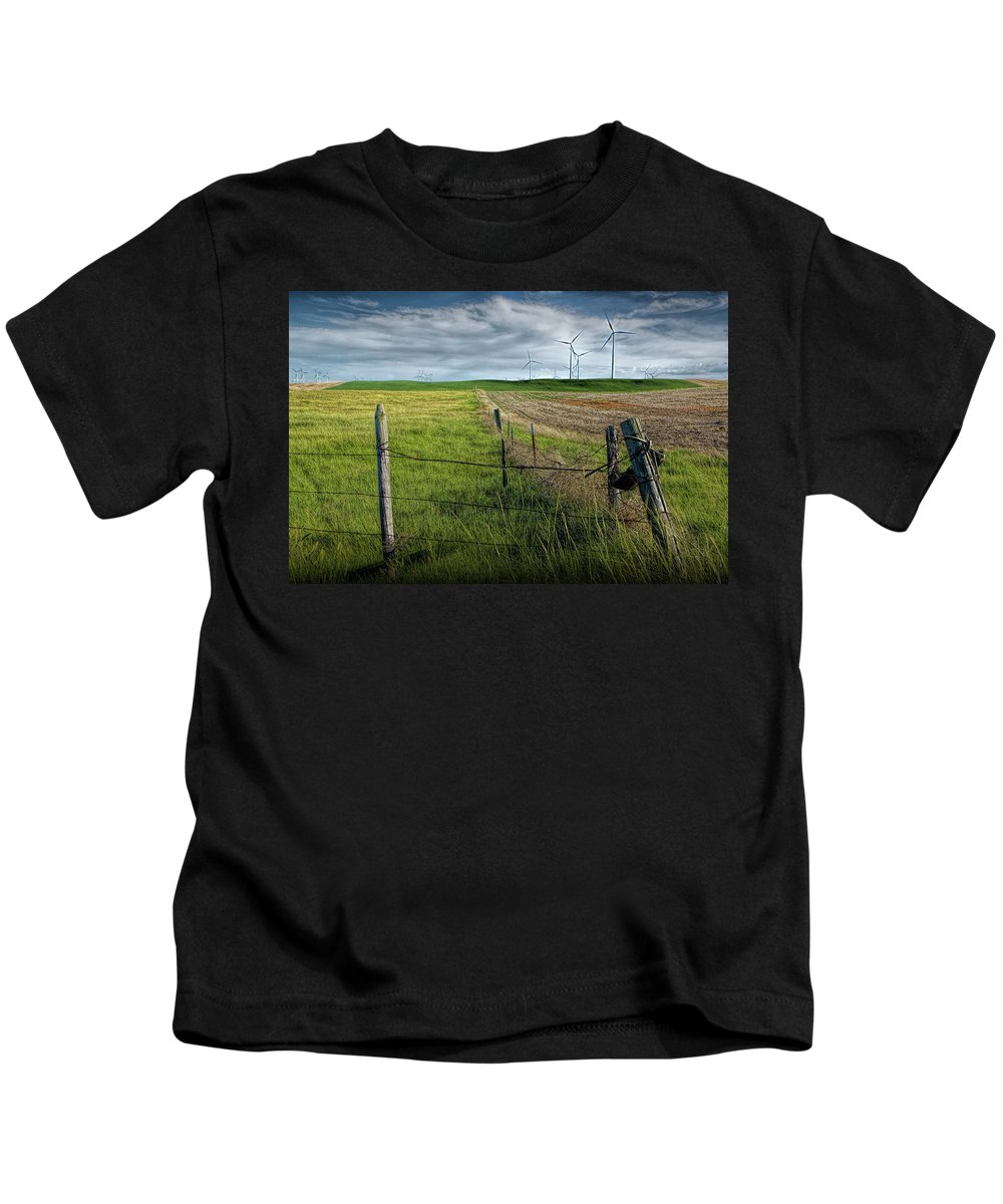 Power Kids T-Shirt featuring the photograph Wind Turbines In A Southern Alberta Farm Field With Barb Wire Fence by Randall Nyhof