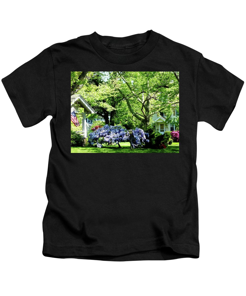 Spring Kids T-Shirt featuring the photograph Wisteria On Lawn by Susan Savad