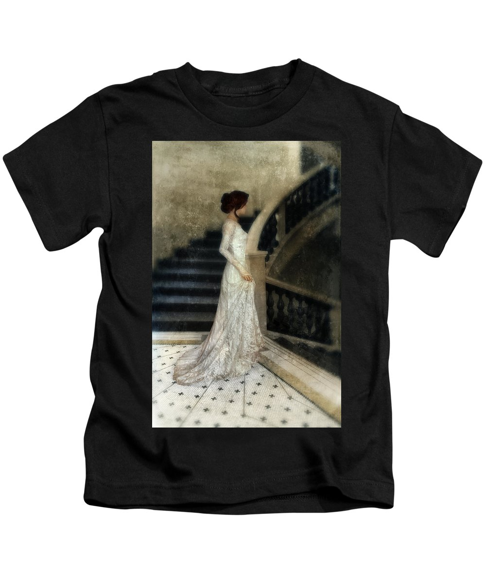 Woman Kids T-Shirt featuring the photograph Woman In Lace Gown On Staircase by Jill Battaglia