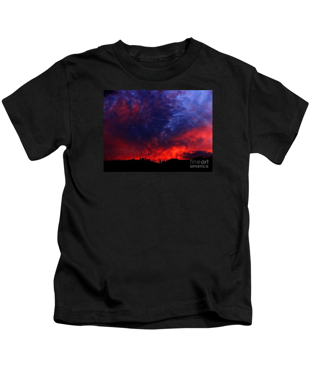 Wyoming Kids T-Shirt featuring the photograph Wyoming Sunset On Fire by Ron Tackett