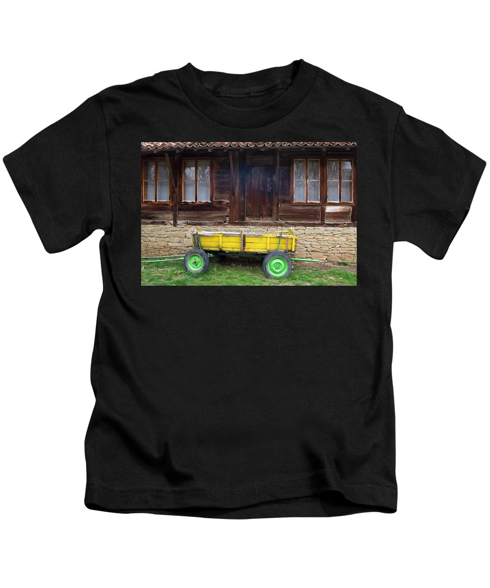 Bulgarian Yellow Cart Kids T-Shirt featuring the photograph Yellow Cart And Green Wheels by Cliff Norton