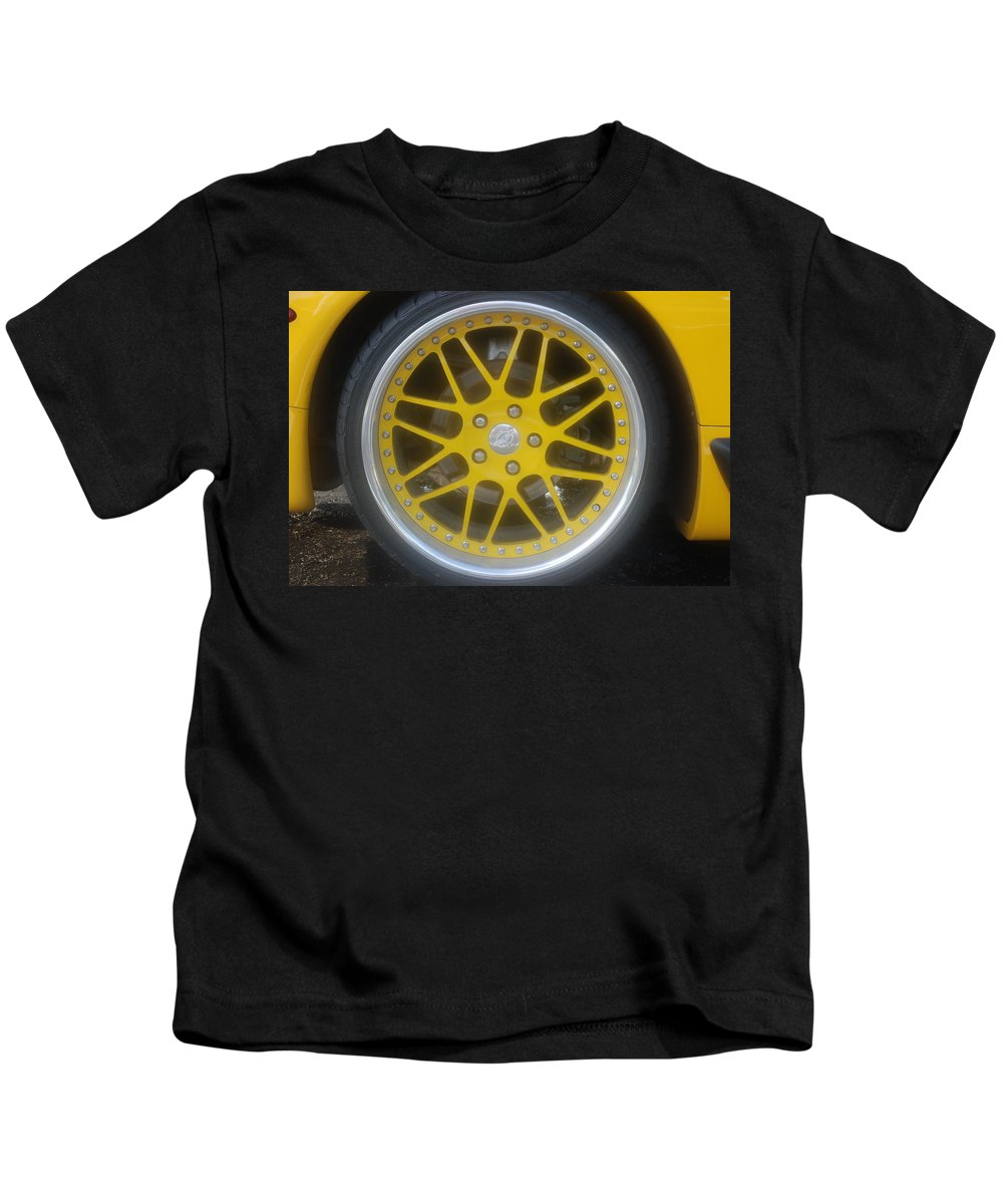 Corvette Kids T-Shirt featuring the photograph Yellow Vette Wheel by Rob Hans