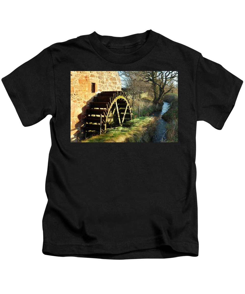 Old Kids T-Shirt featuring the photograph old mill wheel and stream at Preston Mill, East Linton by Victor Lord Denovan
