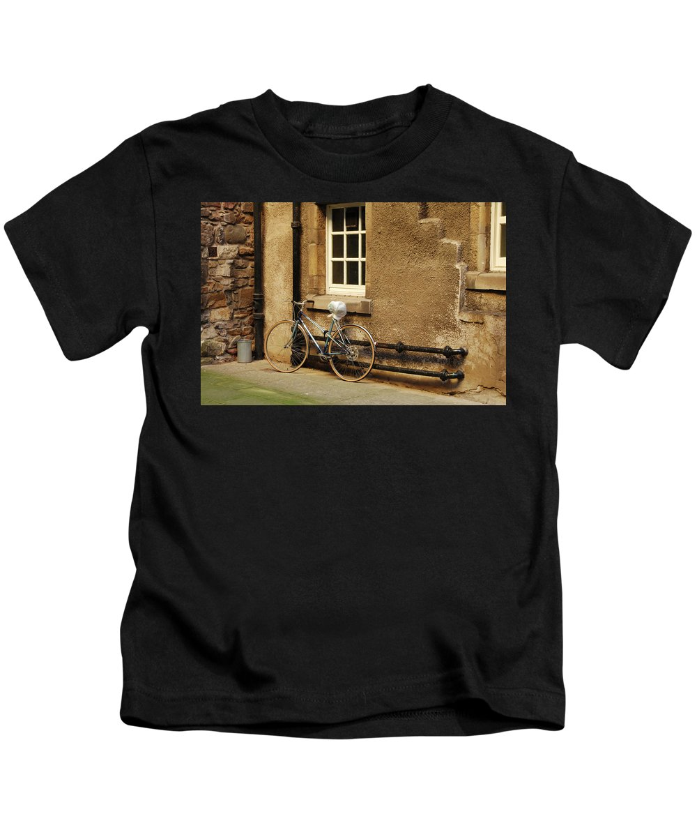 Bicycle Kids T-Shirt featuring the photograph bicycle in Edinburgh close by Victor Lord Denovan