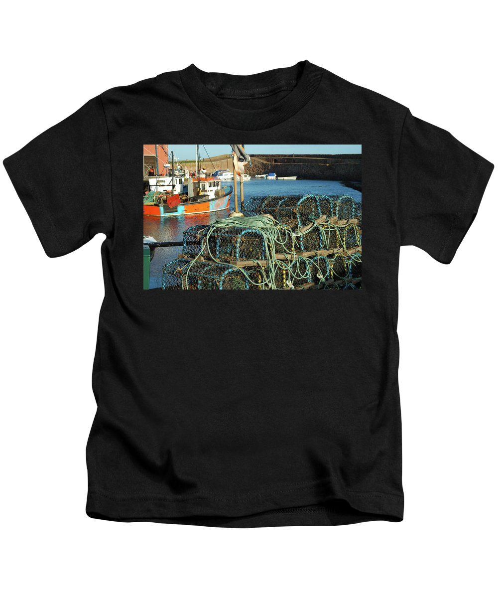 Dunbar Kids T-Shirt featuring the photograph lobster pots and trawlers at Dunbar harbour by Victor Lord Denovan