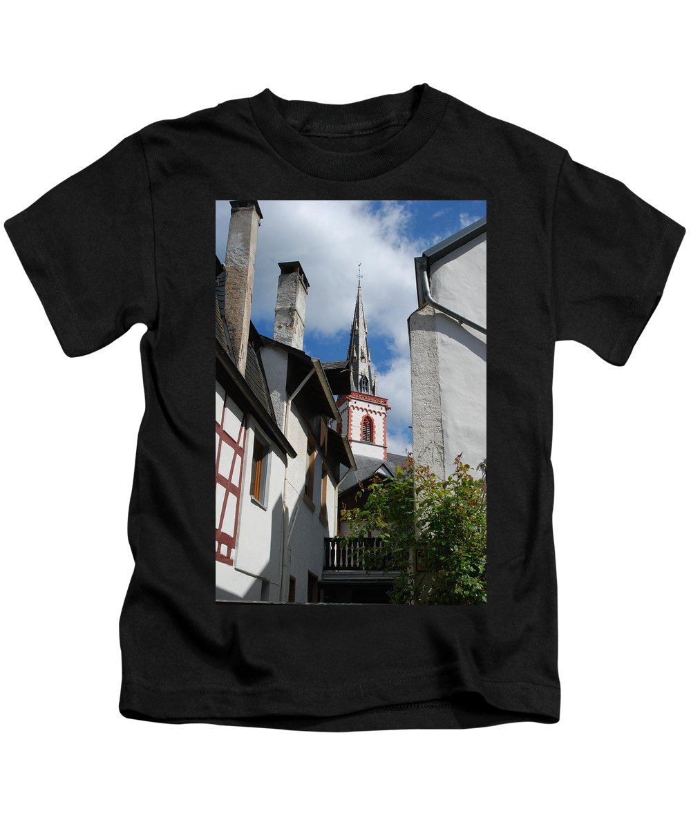 Brickwork Kids T-Shirt featuring the photograph old historic church spire and houses in Ediger Germany by Victor Lord Denovan