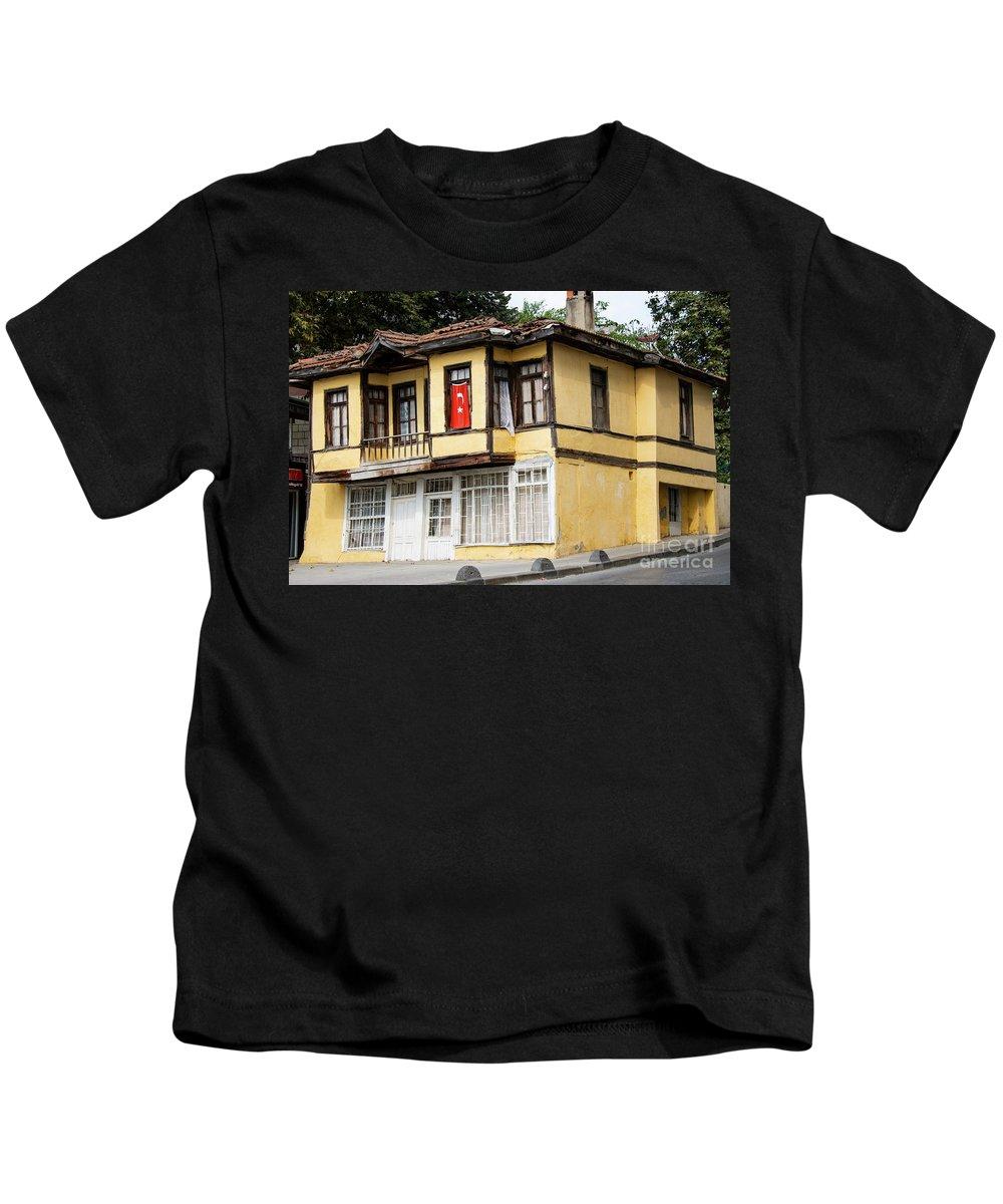 Kemerburgaz Kids T-Shirt featuring the photograph Village Center Structure One by Bob Phillips