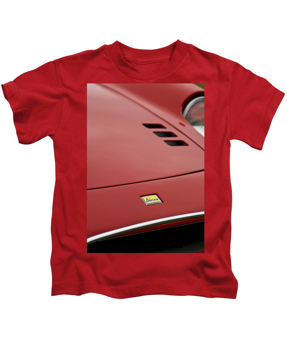 1974 Dino Kids T-Shirt featuring the photograph 1974 Ferrari Dino 246gts Hood Emblem by Jill Reger
