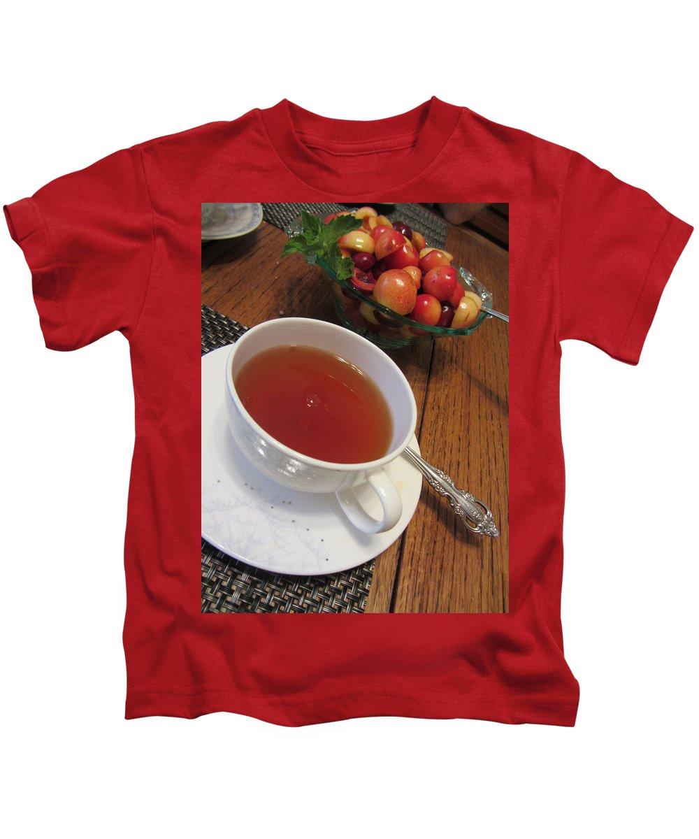 Rainier Cherries Kids T-Shirt featuring the photograph Fine Tea And Cherries by Kathy Clark