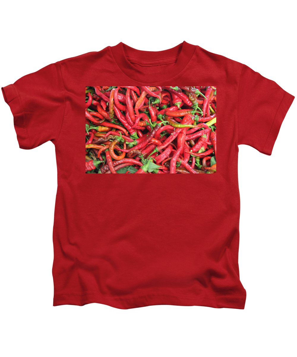 Still Life Kids T-Shirt featuring the photograph Red Hot Chilli Peppers by John Halliday