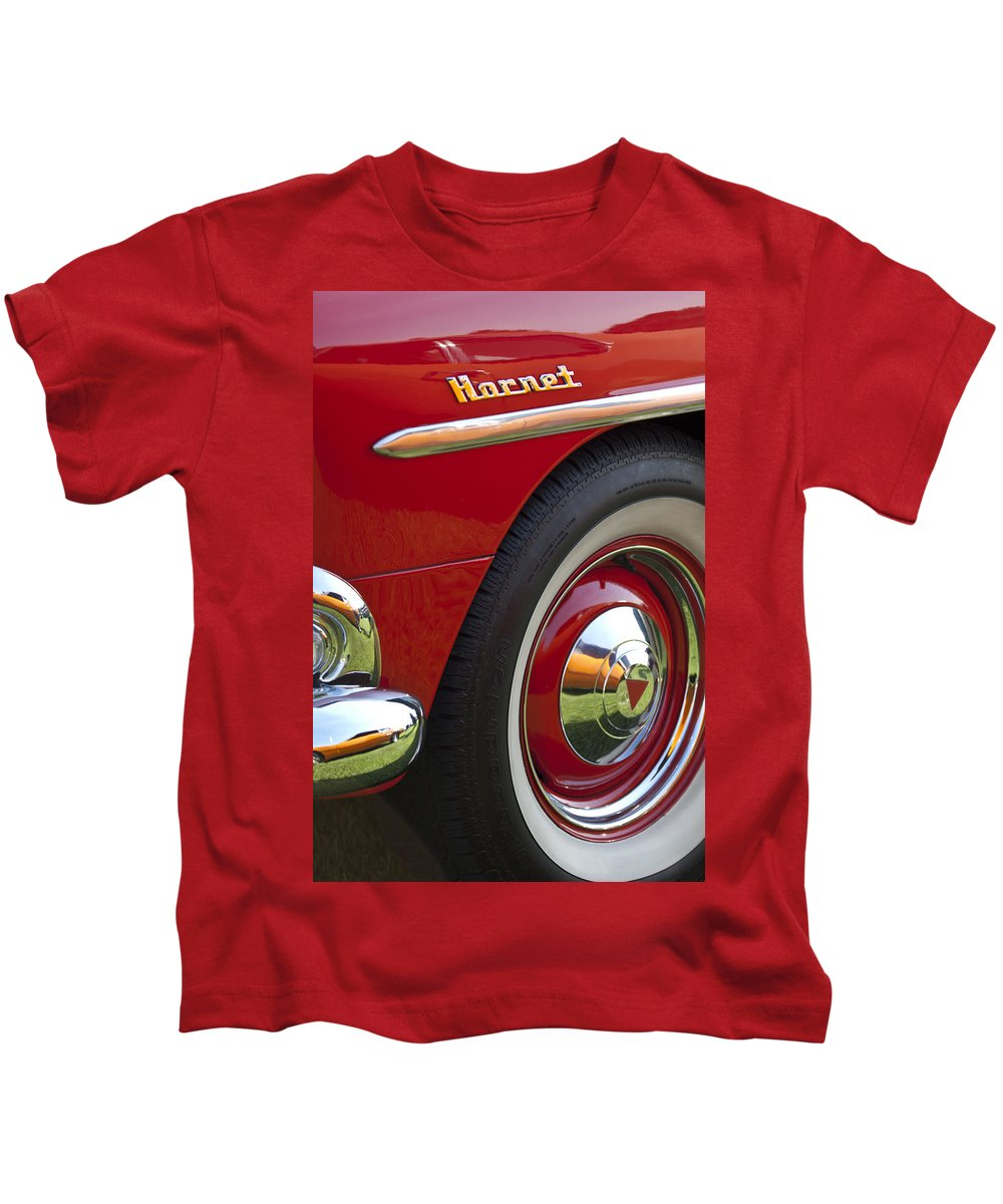 1954 Hudson Hornet Kids T-Shirt featuring the photograph 1954 Hudson Hornet Wheel And Emblem by Jill Reger