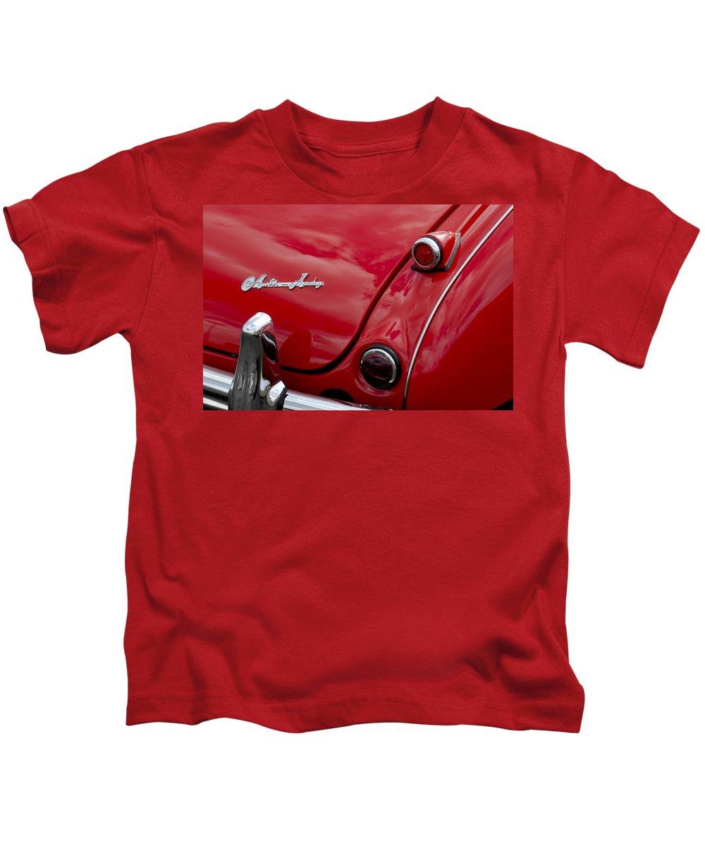 Austin-healey Kids T-Shirt featuring the photograph Austin-healey Tail Light And Emblem by Jill Reger