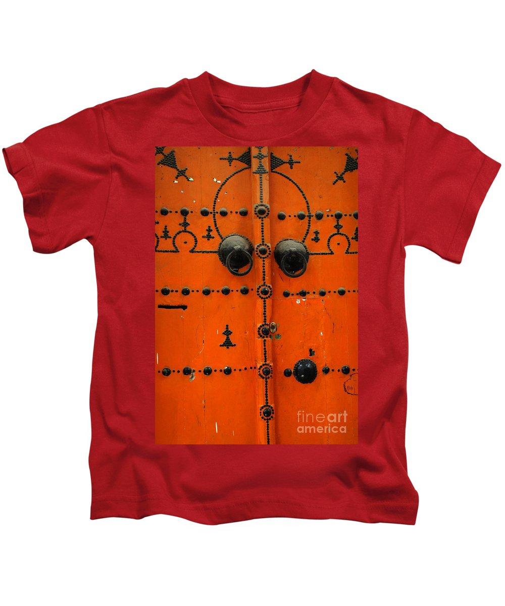 Door Kids T-Shirt featuring the photograph Doorway In Tunisia 6 by Bob Christopher