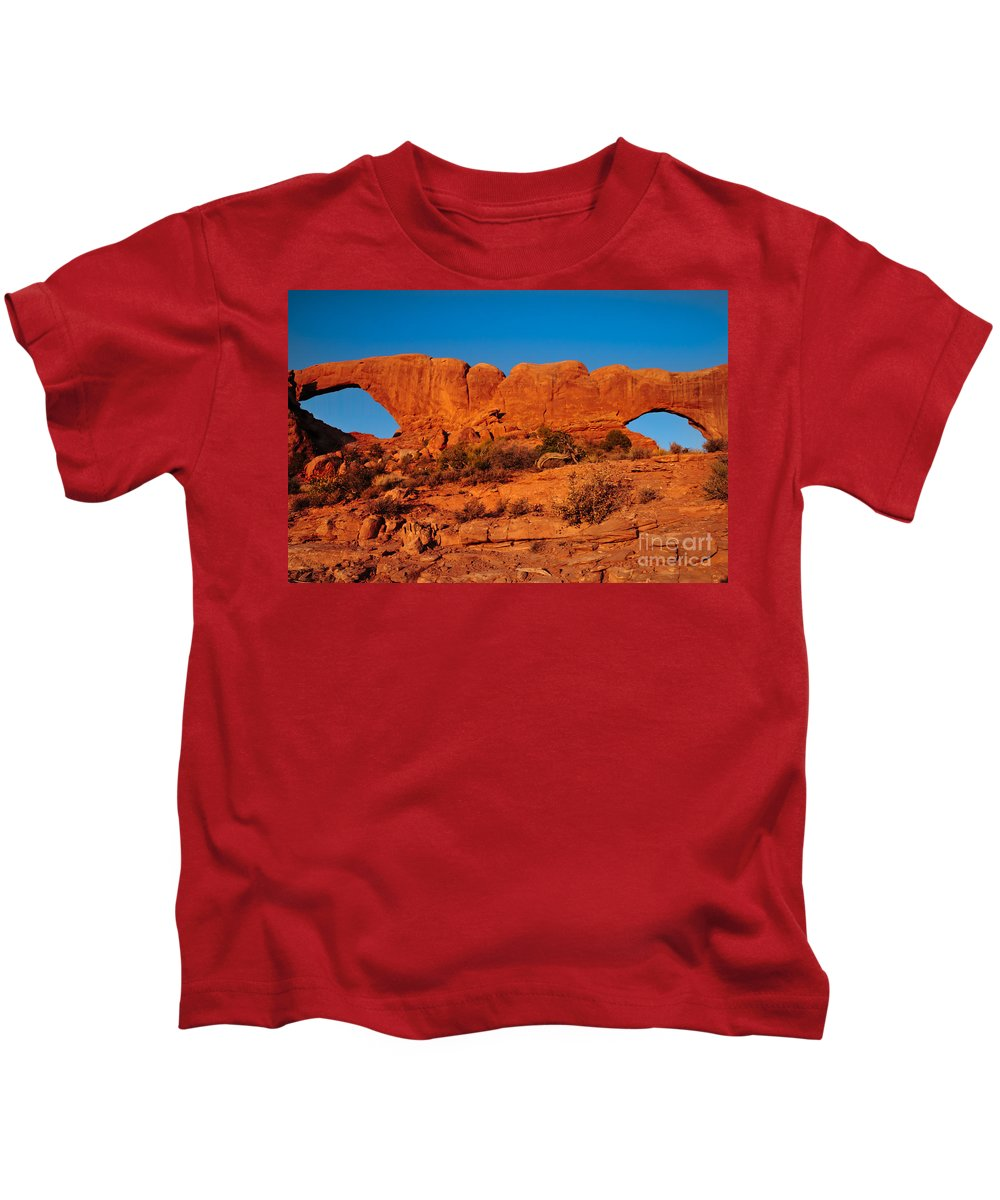 Arches Kids T-Shirt featuring the photograph North And South Windows by Robert Bales