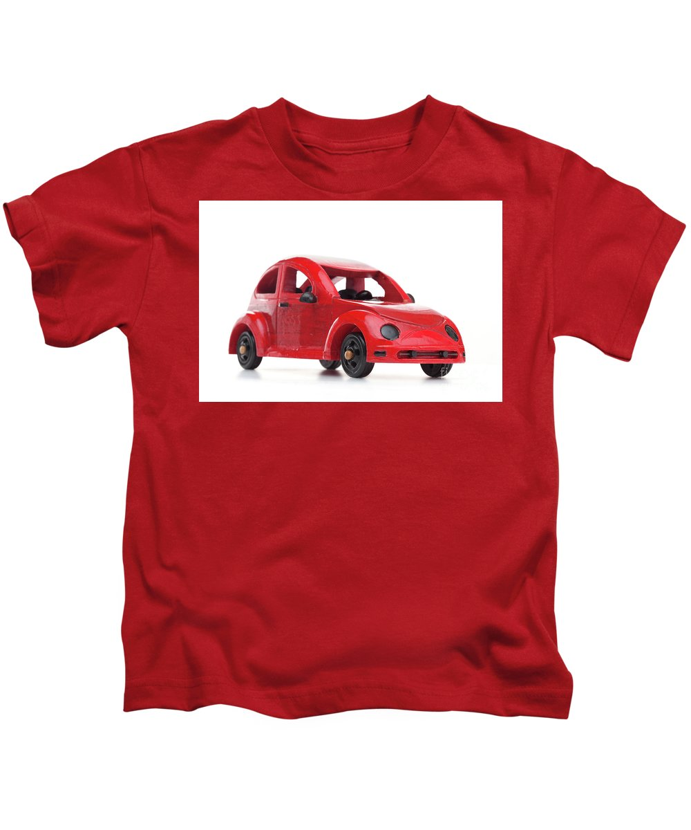 Toy Kids T-Shirt featuring the photograph Red Retro Wooden Toy Car Isolated On White Background by Michal Bednarek