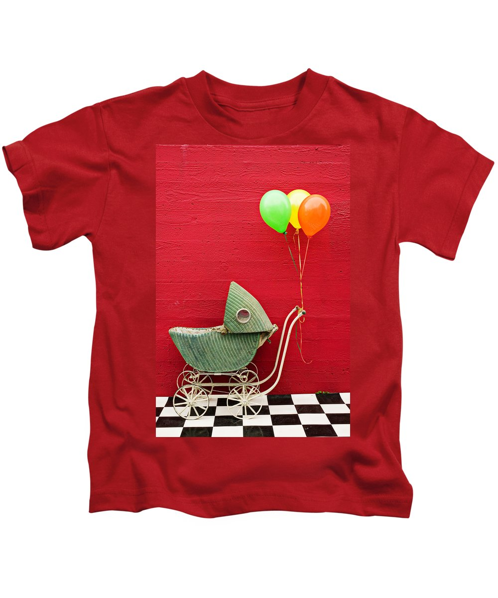 Baby Buggy Kids T-Shirt featuring the photograph Baby Buggy With Red Wall by Garry Gay