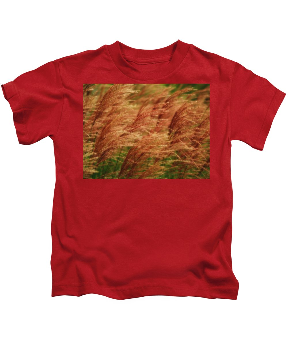 Win Kids T-Shirt featuring the photograph Blowing In The Wind by Gaby Swanson